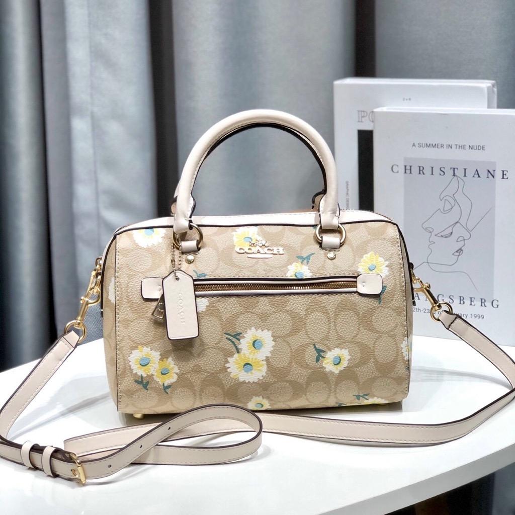 tui-c0-ch-rowan-satchel-in-signature-canvas-with-daisy