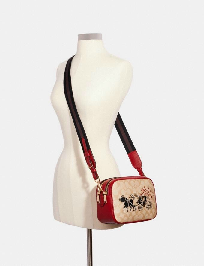 tui-co-ch-lunar-new-year-jes-crossbody-in-signature-canvas-with-ox-and-cariage