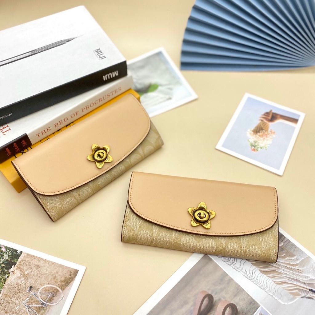 TÚI C🅾️ACH TEA ROSE TWIST   long wallet