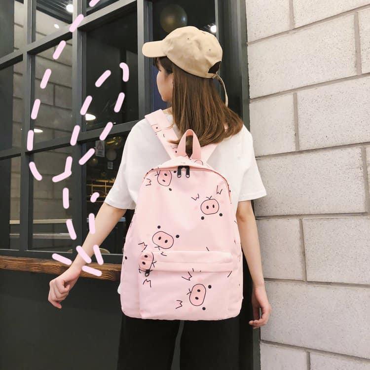 Balo size A4 màu hồng họa tiết lợn