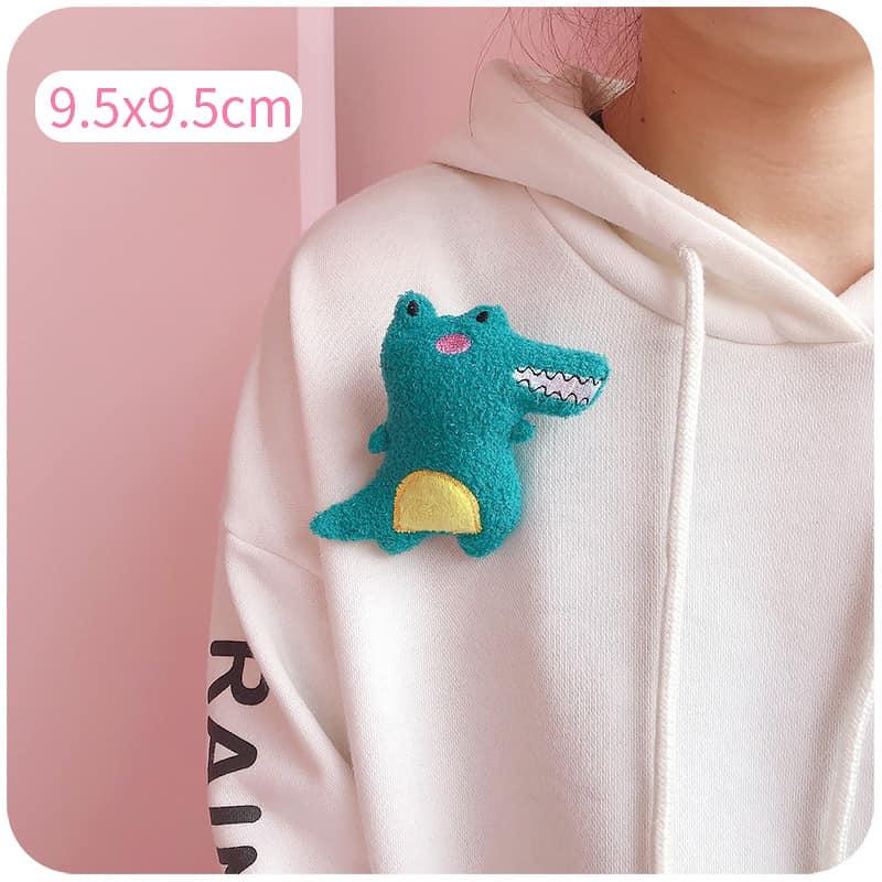 Huy hiệu cá sấu xanh