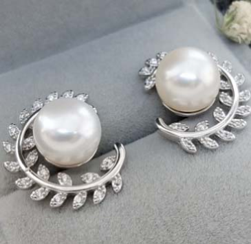 Pearl with Olive leaves holdings Earrings