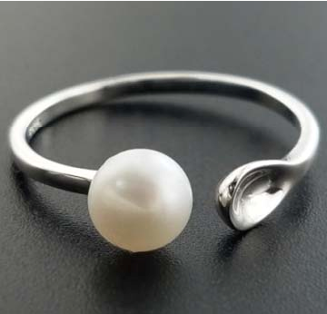 Pearl with Spoon holding Ring