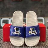 NIKE BENASSI JDI PRINT SLIDE 'HIKER CARTOON - LIGHT BONE'