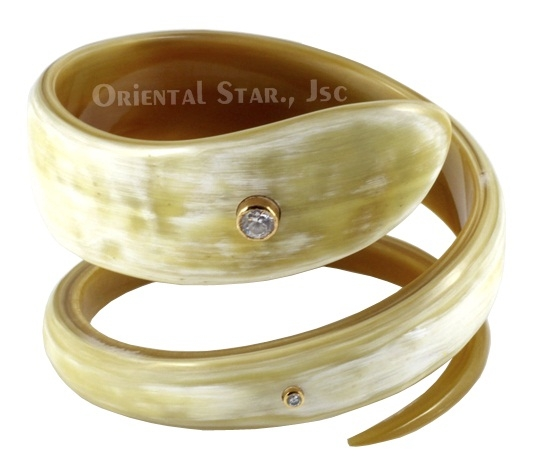 Natural rolling horn bangle bracelet with precious stone