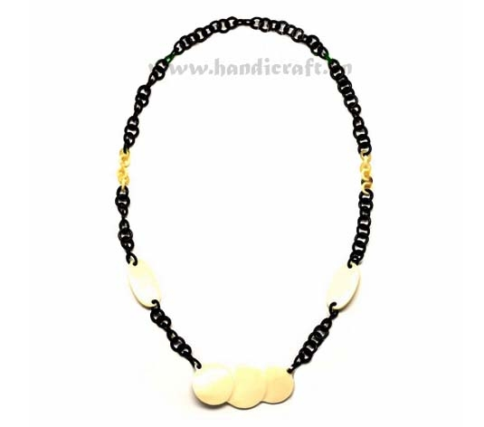 Small black horn links with white horn pendant