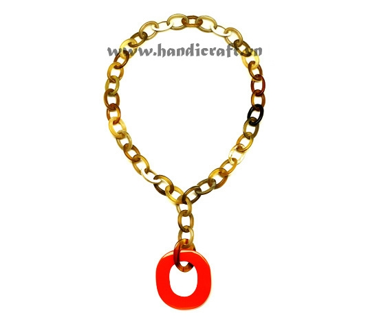 Small oval horn with large lacquer pendant necklace