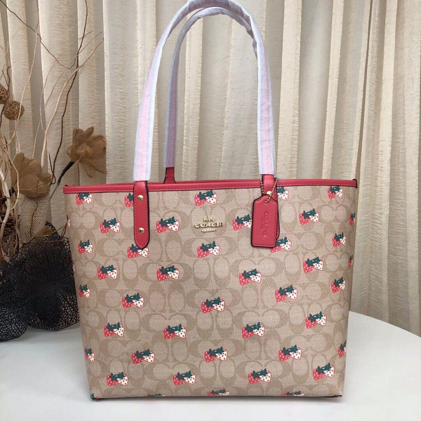 tui-coach-reversible-city-tote-hoa-tiet-dau