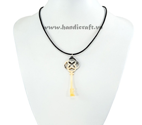 Key shaped horn pendant