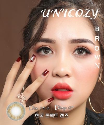 Kính áp tròng UNICOZY BROWN xám nâu sáng - Lens mắt Hàn Quốc