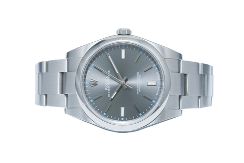 Đồng Hồ Rolex Oyster Perpetual 39 114300 Mặt Số Rhodium