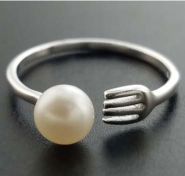 Pearl with Fork holding Ring